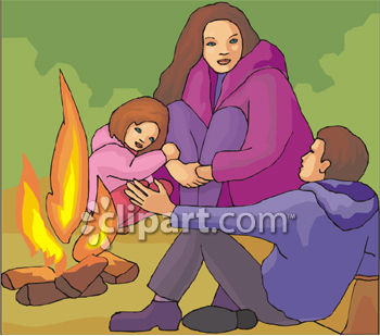Family Of Three Sitting Around A Campfire
