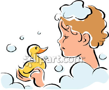 LIttle Kid Playing with a Rubber Duck in a Bubble Bath
