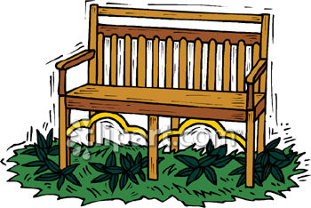 Wooden Garden Bench Sitting in Grass