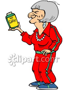 Healthy Old Woman Holding a Bottle of Garlic Tablets