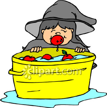 Girl Dressed As Witch Bobbing For Apples