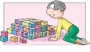 Young Boy Building A Pyramid Of Blocks