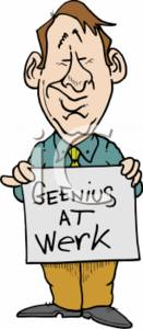 "Businessman Holding a Sign That Says ""Geenius at Werk"""