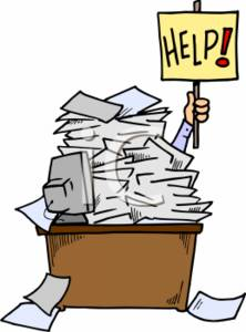 Businessman Holding a Help Sign Up Under a Pile of Papers