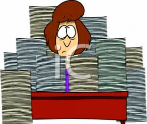 Businesswoman Completely Surrounded with Paperwork