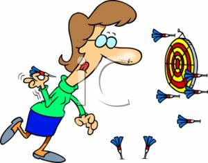 Businesswoman Throwing Darts at a Dartboard