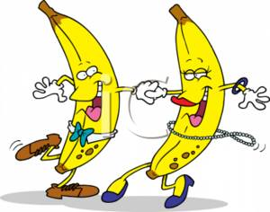 Clipart of a two happy bananas dancing together