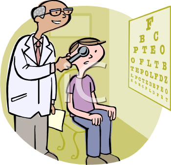 Eye Doctor Doing an Exam on a Boy