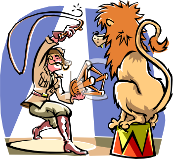 Lion Tamer in the Circus Performing with His Lion