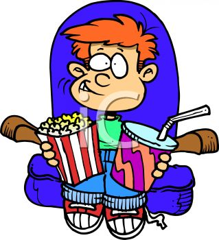 Boy Enjoying Popcorn while Watching a Movie