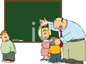 school teacher talking to his students in class royalty free