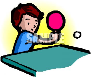Child, a boy, playing table tennis or ping pong