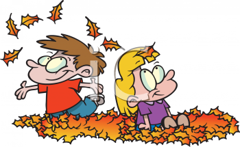 Kids Playing in a Pile of Fall Leaves