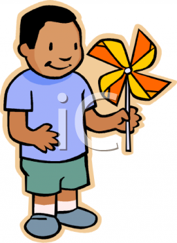 Ethnic Kid Playing with a Pinwheel