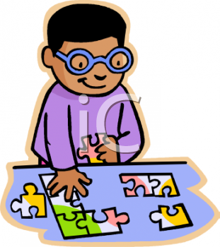African American Boy Putting Together a Jigsaw Puzzle