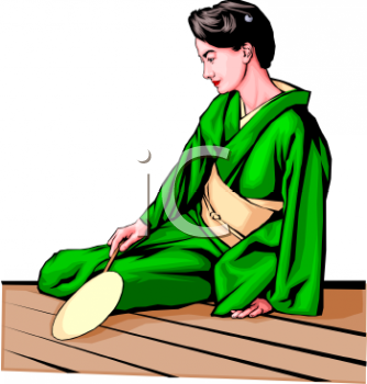 Japanese Woman Sitting on a Wooden Floor