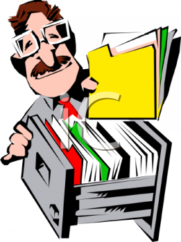 office worker putting a file in a filing cabinet royalty free