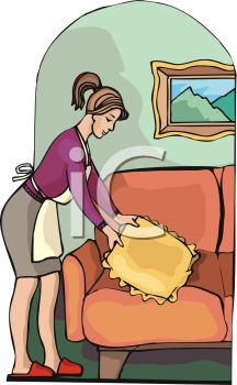 A Woman Fluffing A Couch Pillow