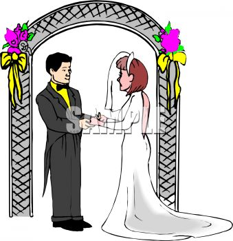 Bride and Groom Standing Under a Wedding Arch