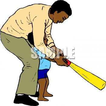 African American Dad Showing His Little Son How to Use a Bat