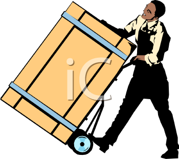 Man Moving a Heavy Crate with a Dolly