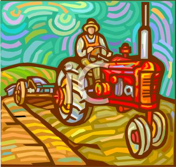 Farmer Riding a Tractor on His Farm