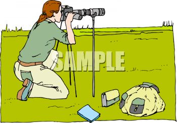 Wildlife Photographer Shooting with a Telescopic Lens