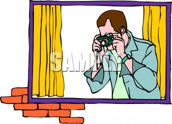 Man Taking a Picture Through a Window