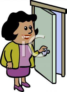 African American Businesswoman Opening a Door