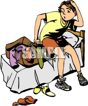 Boy Trying to Get an Over Filled Suitcase Closed