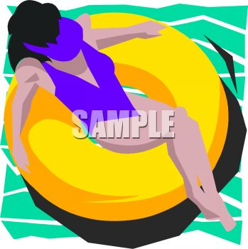 Pretty Woman Relaxing on an Inner Tube in a Pool