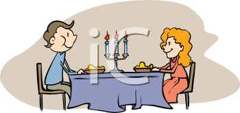Couple - a man and woman having dinner with formal place settings