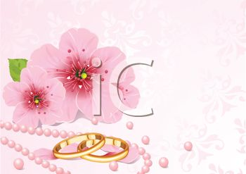 Wedding Rings and Cherry Blossoms on a Wedding Background