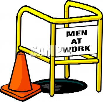 Men at Work Sign Over a Manhole with an Orange Cone