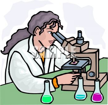 Woman chemist in laboratory looking through a microscope