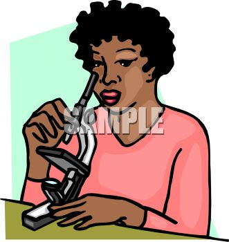 African American woman looking through a microscope