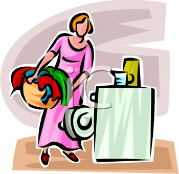 Woman Loading Clothes or Laundry Into a Washer or Washing Machine