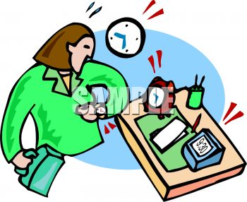 Busy working woman at her desk looking at the time on her wristwatch