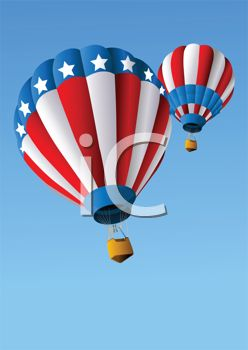 Red, white and blue patriotic themed hot air balloons floating through the sky