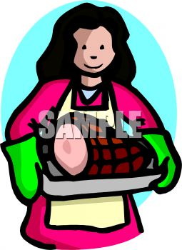 picture of a woman carrying a ham from the oven wearing oven mitts