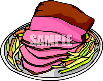 picture of a sliced ham on a plate with vegetables on side