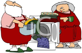 picture of Santa clause loading clean clothes into a laundry basket with mrs clause watching and holding her cup of coffee in a vector clip art illustration