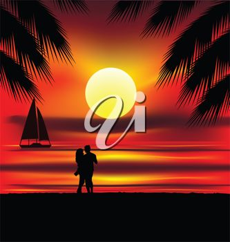 A man and woman hugging on a beach at sunset.