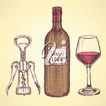 A wine bottle, corkscrew and glass