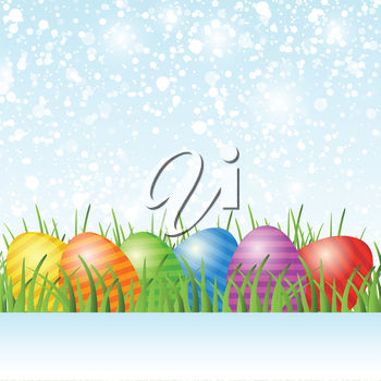 Painted eggs in grass on an easter greeting
