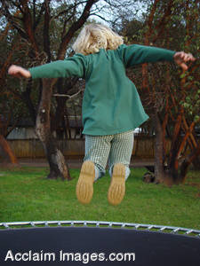 Stock Photo of a Little Girl Jumping on a Trampoline