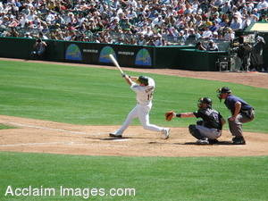 Stock Photo of a Baseball Player Taking a Swing