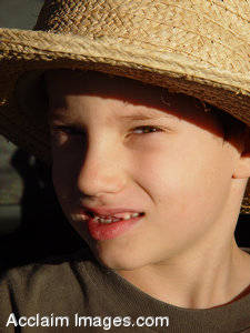 Stock Photography of a Boy Wearing a Hat