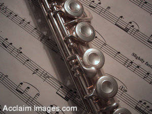 Stock Picture of a Flute On Sheet Music