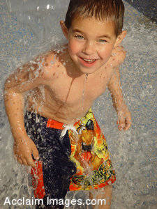 Stock Photo of a Boy Splashing and Playing in Water